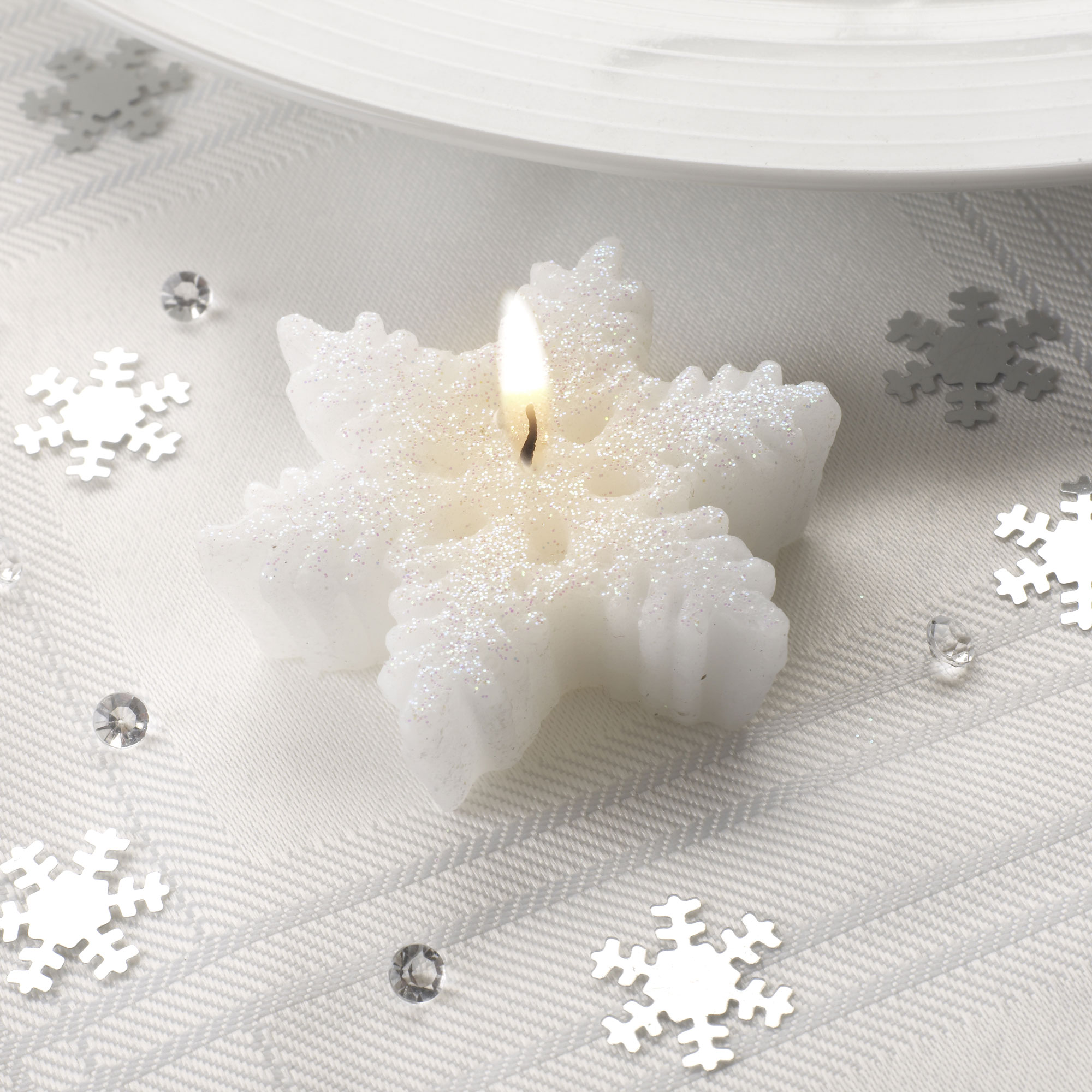 Shimmering Snowflake Shaped Candles